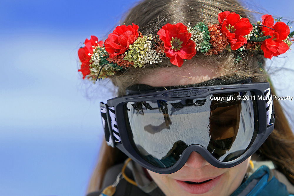 LOVELAND SKI AREA, CO - FEBRUARY 14: Elaine Vardamis of Nederland, Co. wears a floral wreath and googles after a ceremony atop Loveland Ski Area in Colorado at the 20th Annual Marry Me & Ski Free Mountaintop Matrimony on Valentine's Day Monday, February 14th. The mass wedding ceremony was held at noon at 12,050 feet outside of the Ptarmigan Roost Cabin at Loveland. More than 75 couples were pre-registered to get married or renew their vows high on The Continental Divide in this yearly Loveland tradition.  Following the ceremony couples were invited to a casual reception complete with a champagne toast, wedding cake and music. Vardamis married her husband, Dan (not pictured), about eight months ago at the County Clerks office in Boulder, Co. and this was their first official ceremony. (Photo by Marc Piscotty © 2011)