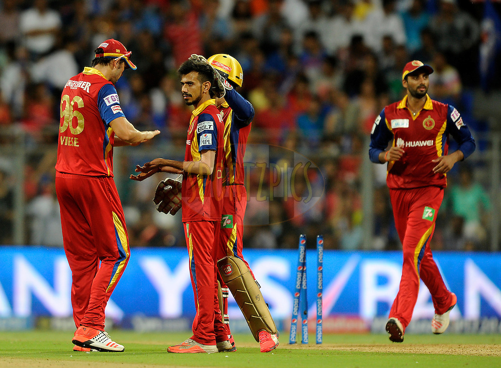 Yuzvendra Chahal of Royal Challengers Bangalore celebrates the wicket of Hardik Pandya of Mumbai Indians during match 46 of the Pepsi IPL 2015 (Indian Premier League) between The Mumbai Indians and The Royal Challengers Bangalore held at the Wankhede Stadium in Mumbai, India on the 10th May 2015.<br /> <br /> Photo by:  Pal Pillai / SPORTZPICS / IPL