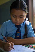 Usha (name changed), aged 10, does her homework in her room in SOS Children's Villages Sanothimi, Bhaktapur, Nepal on 2 July 2015. Usha's entire family perished when her house collapsed in the earthquake on 25th April 2015. Usha is now well integrated into her new family and school. Photo by Suzanne Lee for SOS Children's Villages