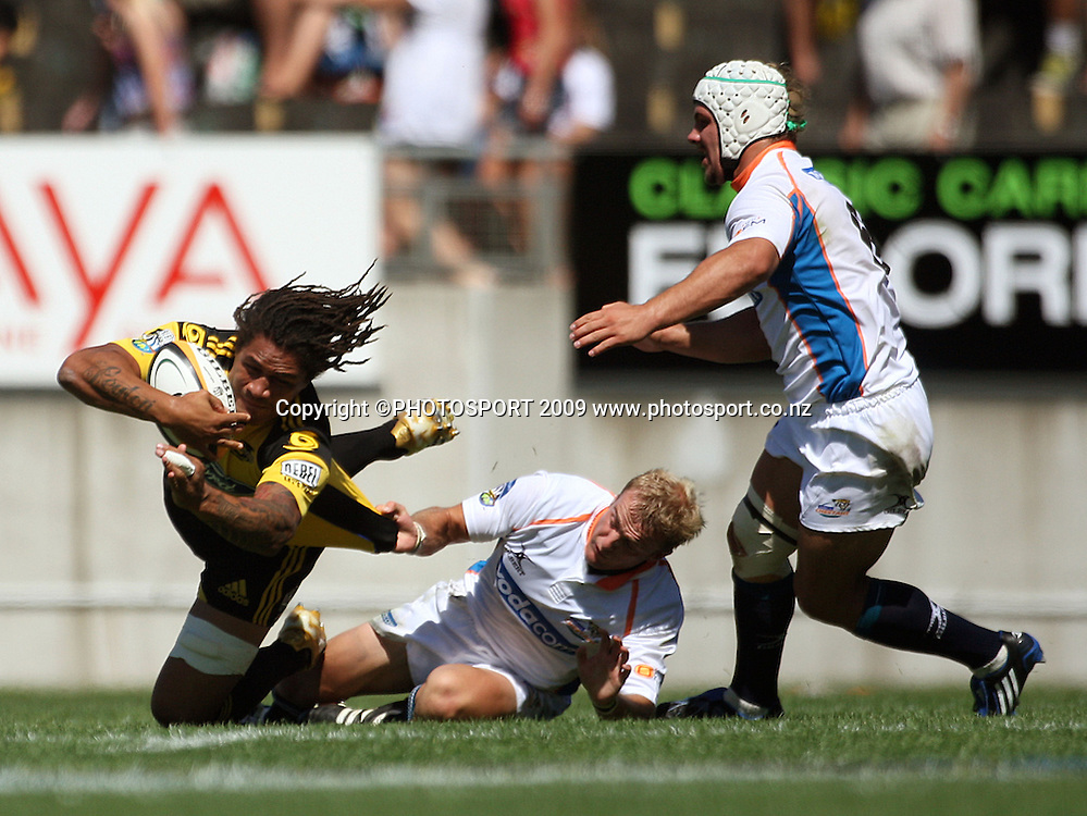 Hurricanes captain Rodney So'oialo is scragged by Sarel Pretorius as Heinrich Brussow closes in. <br /> Super 14 rugby union match, Hurricanes v Cheetahs at Yarrows Stadium, New Plymouth, New Zealand. Saturday 7 March 2009. Photo: Dave Lintott/PHOTOSPORT