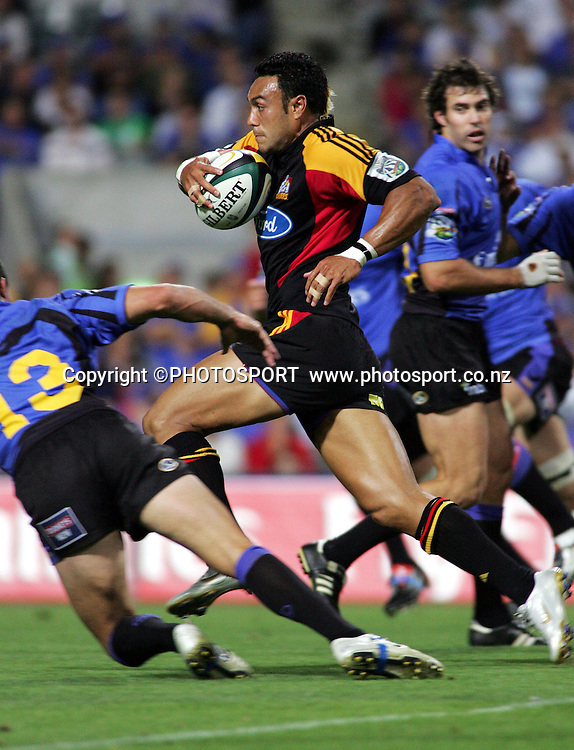 #14 Sosene Anesi runs all the way to the tryline before passing to Malili Muliaina who second later scores a try in the 62nd minuteduring the 2006 Super 14 rugby union match between the Western Force and the Chiefs at Subiaco Oval, Perth, Western Australia, on Friday 24 February, 2006. Final score was Force - 9, Chiefs - 26.  Photo: Christian Sprogoe/PHOTOSPORT