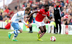 Andy Yiadom of Barnsley goes past Sam Winnall of Sheffield Wednesday - Mandatory by-line: Robbie Stephenson/JMP - 01/04/2017 - FOOTBALL - Oakwell Stadium - Barnsley, England - Barnsley v Sheffield Wednesday - Sky Bet Championship