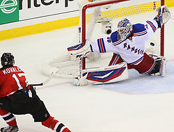 May 25, 2012; Newark, NJ, USA; New Jersey Devils left wing Ilya Kovalchuk (17) scores a goal on New York Rangers goalie Henrik Lundqvist (30) during the first period in game six of the 2012 Eastern Conference finals at the Prudential Center.