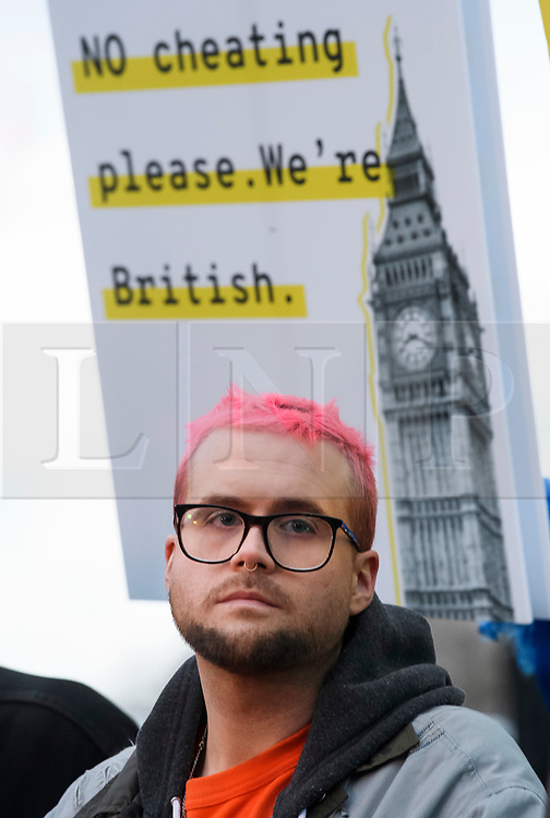 © Licensed to London News Pictures. 29/03/2018. London, UK. Cambridge Analytica whittleblower CHRISTOPHER WYLIE speaking at a demonstration held by Fair Vote, outside the Houses of Parliament in London, calling for a fair vote on the EU referendum. Whistleblowers Shahmir Sanni and Christopher Wylie both spoke at the event attended by a small number of people.. Photo credit: Ben Cawthra/LNP