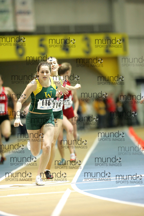 (Windsor, Ontario---12 March 2010) Courtney Smith of University of Alberta Golden Bears   competes in the 4x200m relay heats at the 2010 Canadian Interuniversity Sport Track and Field Championships at the St. Denis Center. Photograph copyright Sean Burges/Mundo Sport Images. www.mundosportimages.com