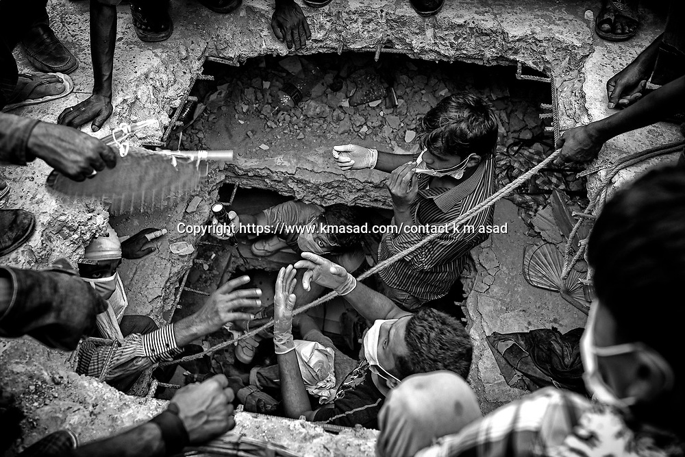 Rescue workers take part in the rescue of the eight-storey building Rana Plaza which collapsed at Savar, outside Dhaka, Bangladesh April 26 2013.