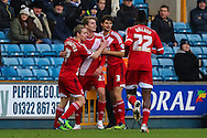 Patrick Bamford of Middlesbrough (2nd left) celebrates scoring his team's second goal against Millwall to make it 0-2 during the Sky Bet Championship match at The Den, London<br /> Picture by David Horn/Focus Images Ltd +44 7545 970036<br /> 06/12/2014