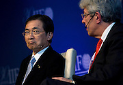 Yoshio Kono, president and CEO of  Norinchukin Bank, listens on as Michel M. Lies, group CEO of Swiss Re, Ltd., speaks during a special session on Japan's reconstruction following last year's earthquake and tsunami during the International Institute of Finance conference in Tokyo, Japan on 11 Oct. 2012. Photographer: Robert Gilhooly