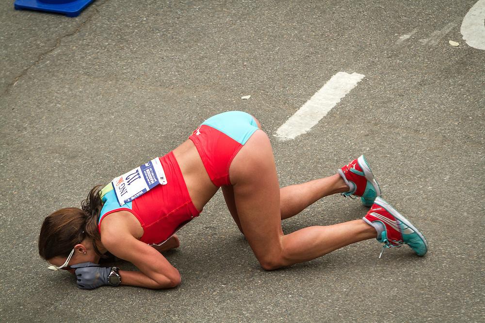ING New York CIty Marathon: Sabrina Mockenhaupt, Germany, kneels and kisses ground after finishing seventh