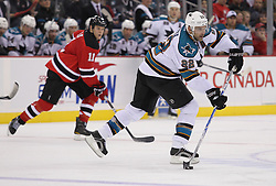Oct 21; Newark, NJ, USA; San Jose Sharks defenseman Dan Boyle (22) skates with the puck during the second period at the Prudential Center.