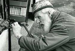 Elderly man doing DIY UK 1991