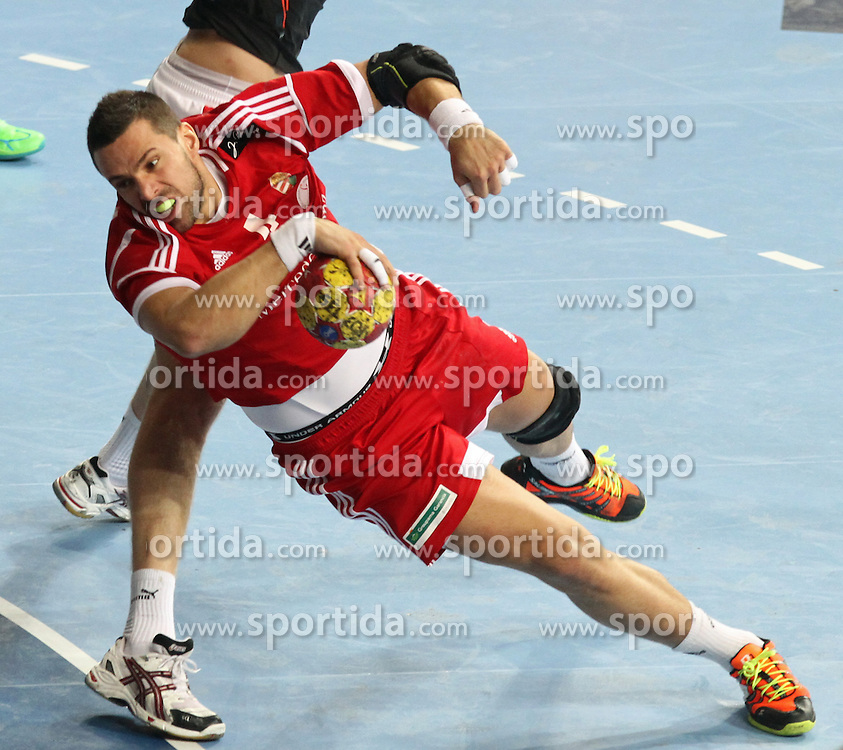 12.01.2013 Barcelona, Spain. IHF men's world championship, Quarter-Final. Picture show  Szabolcs Szollosi  in action during game between Denmark vs Hungary at Palau ST Jordi (Photo by Sportida Photo Agency)