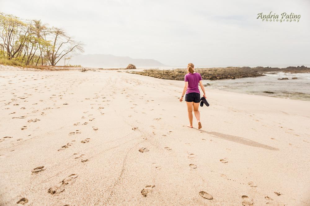 Woman walking on Playa Carmen, Costa Rica