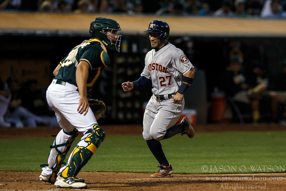 OAKLAND, CA - JULY 19:  Jose Altuve #27 of the Houston Astros scores a run past Matt McBride #29 of the Oakland Athletics during the fifth inning at the Oakland Coliseum on July 19, 2016 in Oakland, California. The Oakland Athletics defeated the Houston Astros 4-3 in 10 innings.  (Photo by Jason O. Watson/Getty Images) *** Local Caption *** Jose Altuve; Matt McBride