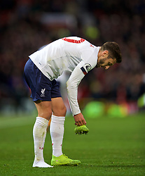 MANCHESTER, ENGLAND - Saturday, October 19, 2019: Liverpool's Adam Lallana retrieves his right boot during the FA Premier League match between Manchester United FC and Liverpool FC at Old Trafford. (Pic by David Rawcliffe/Propaganda)