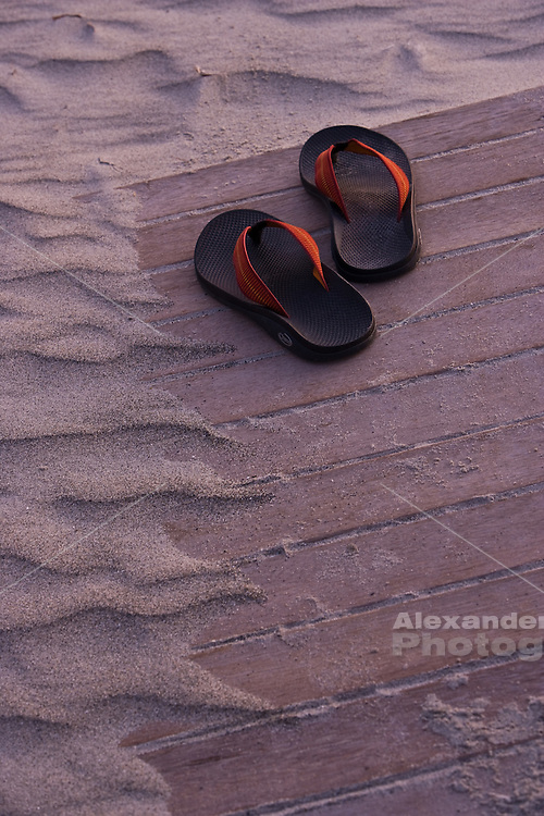 Newport, RI. - Flip flops left on the beach board walk at the edge of the sand