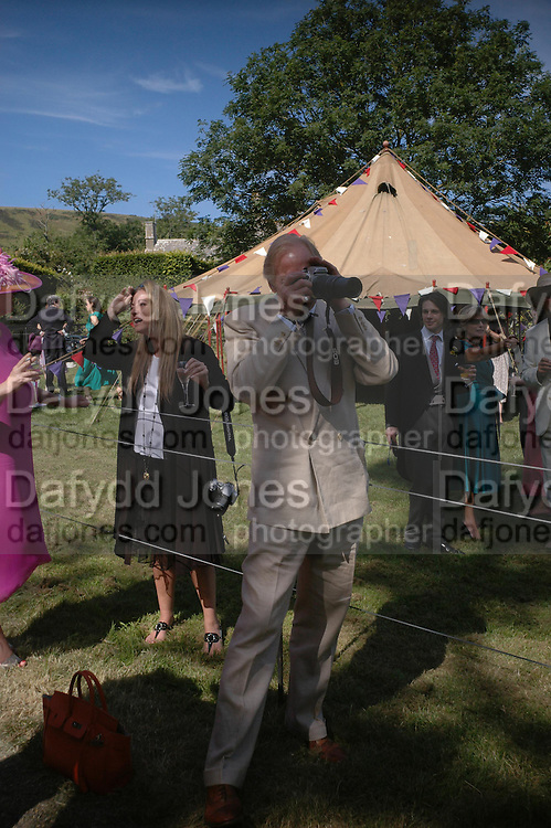 Charles Dance. Marriage of Emilia Fox to Jared Harris. St. Michael's and All Angels. Steeple. Nr. Wareham. Dorset. 16 July 2005. ONE TIME USE ONLY - DO NOT ARCHIVE  © Copyright Photograph by Dafydd Jones 66 Stockwell Park Rd. London SW9 0DA Tel 020 7733 0108 www.dafjones.com