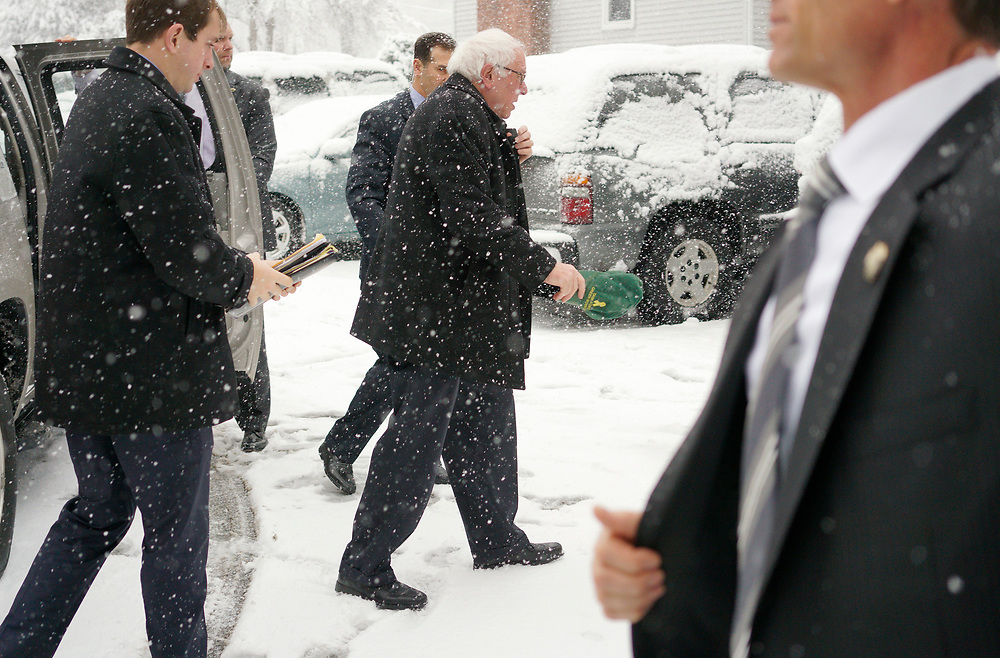 U.S. Democratic presidential candidate Bernie Sanders arrives in  a driving snowstorm on the way to a campaign event in Manchester, New Hampshire February 5, 2016.  REUTERS/Rick Wilking
