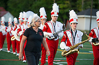 Debbie Gibson marches in with the Sachems Marching Band for Friday night's home opener at Jim Fitzgerald Field.  (Karen Bobotas/for the Laconia Daily Sun)