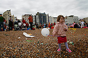 Children play and frolic on the beach in Brighton where the Children's Parade end. The Children's Parade which is the traditional  beginning of the Brighton Festival.
