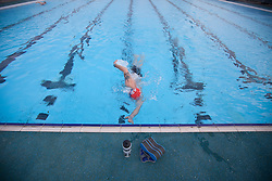 © London News Pictures. 28/03/12. Local open swimmer Robert Gozdanovits prepares himself for training in the 50m Olympic sized pool. Charlton Lido in South London, opens today 28/03/13 after extensive refurbishment work to the heated Olympic sized outdoor pool in Charlton, London, England. Picture credit should read Manu Palomeque/LNP