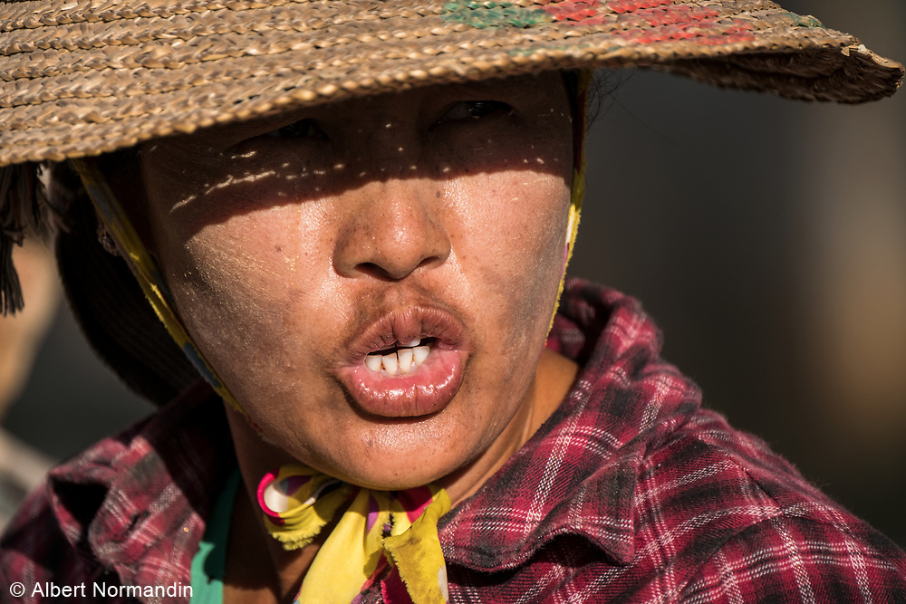 Road construction worker with big hat, Taunggyi, Myanmar