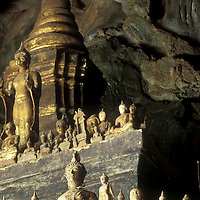 Asia, Laos, Ban Pak Ou, Thousands of statues of Buddha fill lower entrance to Pak Ou Caves along Mekong River