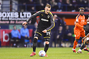 AFC Wimbledon player Joe Pigott clears the ball from defence in the first half during the EFL Sky Bet League 1 match between Luton Town and AFC Wimbledon at Kenilworth Road, Luton, England on 23 April 2019.