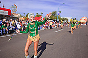 03 JANUARY 2009 -- PHOENIX, AZ: Mary Zerbel (CQ) from the Sun City Poms, in Sun City, leads the Poms down Central Ave during the annual Ft. McDowell Fiesta Bowl parade through Phoenix, AZ. More than 150,000 spectators line the parade routes which starts in north Phoenix and winds down Central Ave and 7th Street before ending in central Phoenix. More than 100 units march in the parade.  PHOTO BY JACK KURTZ