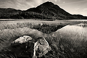 A crystal clear, calm lake, Llyn Cwm Bychan,  sits beneath the Rhinogydd hills, from where the Roman Steps lead up over a col, and down into the valleys beyond. It is thought however that the 'Roman' steps may be more of a Drover's Path than Roman thoroughfare?