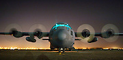 An Air Force Reserve C-130 Hercules is readied for takeoff at Sather Air Base, Iraq, on Wednesday, April 19, 2006. The aircraft is from the 302nd Airlift Wing at Peterson Air Force Base, Colo. (U.S. Air Force photo/Master Sgt. Lance Cheung)<br />