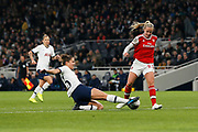 Hannah Godfrey tackles Beth Mead during the FA Women's Super League match between Tottenham Hotspur Women and Arsenal Women FC at Tottenham Hotspur Stadium, London, United Kingdom on 17 November 2019.