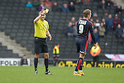 Rotherham Midfielder Danny Ward is shown a yellow card during the Sky Bet Championship match between Milton Keynes Dons and Rotherham United at stadium:mk, Milton Keynes, England on 9 April 2016. Photo by Dennis Goodwin.