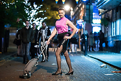 "© Licensed to London News Pictures . 28/10/2018. Manchester, UK. A man dressed as Freddie Mercury performing in the video to Queen's "" I want to break free "" on Canal Street in Manchester City Centre . Revellers on a night out , many in fancy dress , on the weekend before Halloween . Photo credit: Joel Goodman/LNP"