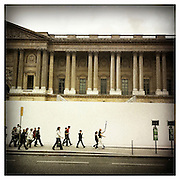 10-4-11 --- A school group is led past the Cour Carree.