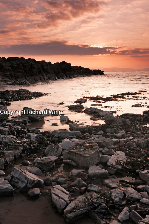Portrait shot of the setting sun at Kilve Beach, about half an hour before it finally set. I deliberately left the rocks on the left in shadow.