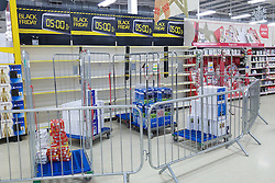 © Licensed to London News Pictures . 26/11/2015 . Manchester , UK . Preparations for Black Friday at a branch of Tesco in Salford this evening (Thursday 26th November) as Tesco branches are due to close for five hours ahead of Black Friday sales starting at 5am on Friday 27th November 2015 . Last year (2014) scuffles and fights were reported amongst queueing bargain-hunters . Photo credit: Joel Goodman/LNP