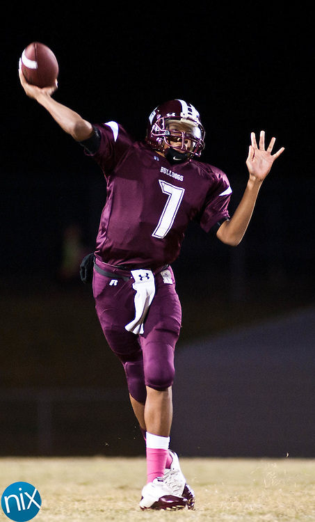 Jay M. Robinson quarterback Bruce Dixon passes against Central Cabarrus Friday night in Concord. (Photo by James Nix)