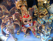 Masks seen from a souvenir shop window in Venice, Italy. (Sam Lucero photo)