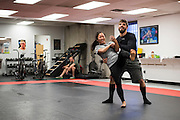 Bi Nguyen of Vietnam dances before training at Jackson Wink MMA in Albuquerque, New Mexico on June 10, 2016.