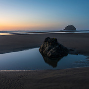 Low tide and sunset on Arcadia Beach. Oregon.