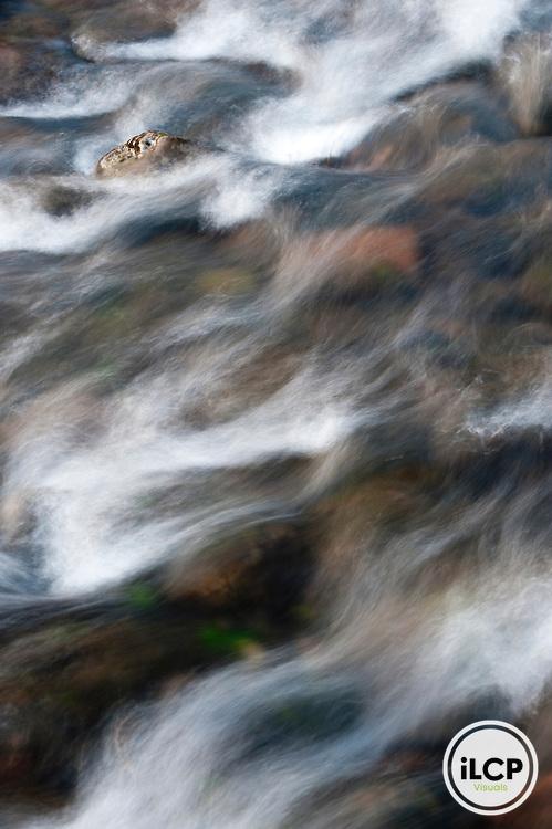 Time exposure of wavelets on stream.