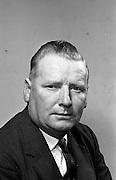 1/7/1964<br /> 7/1/1964 <br /> 1 July 1964<br /> <br /> Photos of Mr. Noel Hayden of Palgrave Murphy at the office