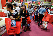People shop at the 37th anniversary Asian American Expo., at Pomona Fairflex on Sunday January 14, 2018 in Los Angeles, the United States. Asian American Expo  featuring arts, performances, vendors galore, entertainment, and traditional Chinese New Year ceremonies with dignitaries and the Dragon Dance .(Xinhua/Zhao Hanrong)<br /> <br /> (Photo by Ringo Chiu)<br /> <br /> Usage Notes: This content is intended for editorial use only. For other uses, additional clearances may be required.