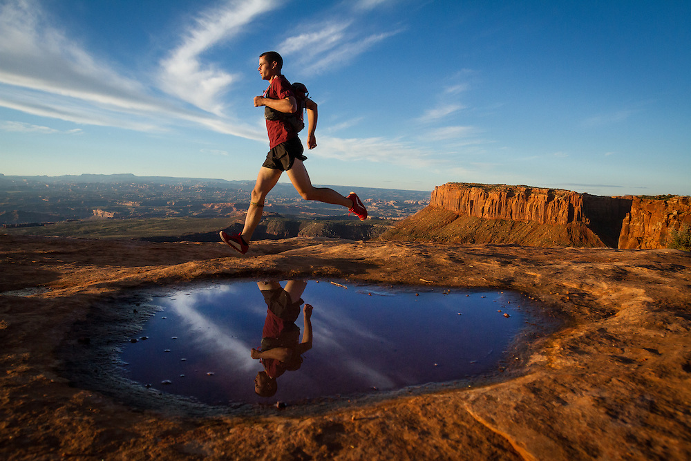 A trail runner taking a morning run along the canyon rim.<br />