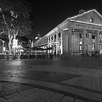 Boston B&amp;W photography of the famous Quincy Market in Downtown Boston. This historic and iconic New England city of Boston night scenery photography image is available as museum quality photography prints, canvas prints, acrylic prints or metal prints. Fine art prints may be framed and matted to the individual liking and decorating needs:<br />