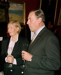 SIR DAVID & LADY RAMSBOTHAM he is chief Inspector of HM Prisons, at a reception in London on 22nd May 1997.LYM 23 2ORO
