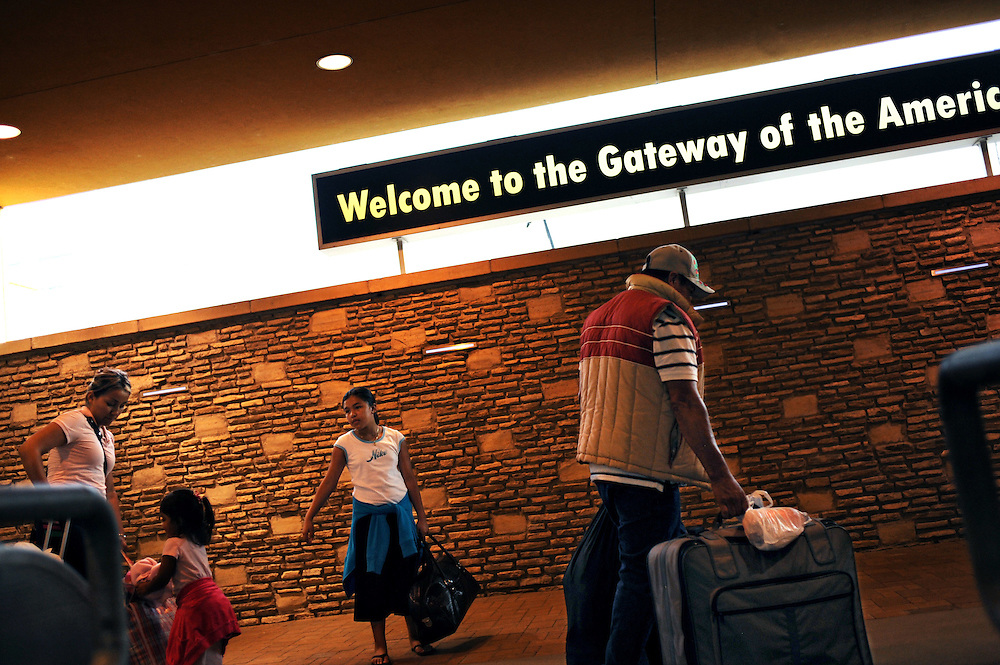 "A family walks past a sign that says ""Welcome to the Gateway of the Americas"" on the ""Gateway to Americas Bridge"" on August 19, 2010 in Laredo, Texas.  City officials say negative attitudes about the city's more dangerous sister Nuevo Laredo have kept tourists from coming and effected the over all economics of the town. Laredo also depends heavily on tourism from Mexico, as people from northern Mexico come to the border city to make purchases on merchandise like designer clothes that they cannot find cheaply in their country, but since Mexico's border region has become increasingly violent, store owners in Laredo, Texas say Mexican shoppers are staying home."
