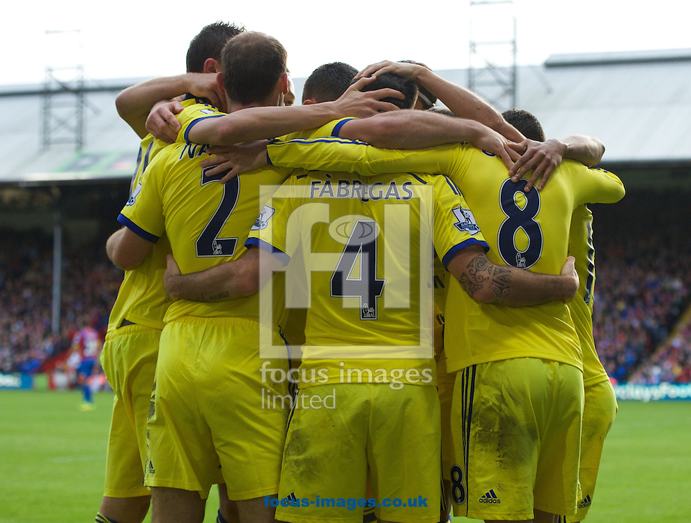 Cesc Fabregas (4) of Chelsea celebrates after scoring the second goal with his team mates to make it 0-2 during the Barclays Premier League match at Selhurst Park, London<br /> Picture by Alan Stanford/Focus Images Ltd +44 7915 056117<br /> 18/10/2014