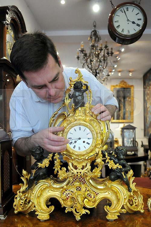 26/03/2010 Mark Coxhead, 40,  begins the long task of changing the hundreds of clocks in his clock shop ahead of BST.Mark and his father opened Gutlin Clocks and Antiques in 1994 on Kings Road in Chelsea and have sold clocks to the Royal Family and are responsible for clocks at the Home Office, Scotland office and all of London's Law Courts